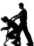 Achtermassagetherapie met stoelsilhouet Stock Afbeeldingen