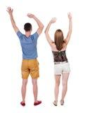 Achtermening van blije paar het vieren overwinningshanden omhoog Royalty-vrije Stock Foto