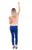 Achtermening van dansende jonge mooie vrouw Stock Foto's