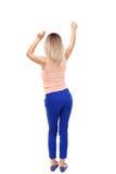 Achtermening van dansende jonge mooie vrouw meisje het letten op Stock Foto