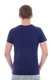Achtermening van de jonge mens in blauwe die t-shirt op wit wordt geïsoleerd Stock Foto