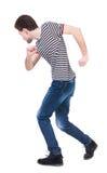 Achtermening van de lopende mens het lopen van kerel in motie royalty-vrije stock foto's