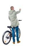 Achtermening van een mens met een fiets stock fotografie