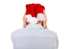 Achtermening van een Mens in Santa Hat stock afbeeldingen