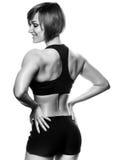 Achtermening van geschikte vrouwelijke atleet tegen van witte achtergrond Royalty-vrije Stock Foto's