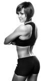Achtermening van geschikte vrouwelijke atleet tegen van witte achtergrond Stock Foto's