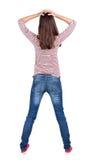 Achtermening van geschokte vrouw in jeans Stock Fotografie