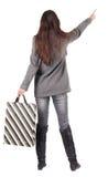 Achtermening van het richten van vrouw. Stock Foto's