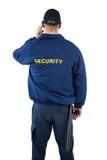 Achtermening van veiligheidsagent die aan oortelefoon luisteren royalty-vrije stock afbeelding