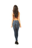 Achtermening van vrouwen shirtless dragende jeans stock foto's