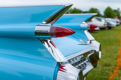 Achterrode lichten van een van de autocadillac van de ware grootteluxe Coupé DeVille, de nadruk van 1959 in de voorgrond Royalty-vrije Stock Foto's