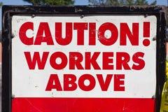 Achtung-Arbeitskräfte oben Lizenzfreies Stockfoto
