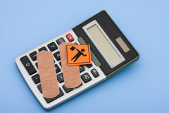 Achtung auf Gesundheitspflege-Kosten Stockbild