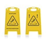 Achtung rutschgefahr. Two achtung rutschgefahr, yellow color Stock Photo