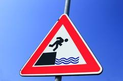 Achtungs-Gefahr des Fallens Stockfotos