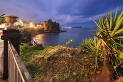 Aci Castello Sicily. Ancient Castel by the sea in Aci Castello Sicily - Italy at dusk Stock Photography