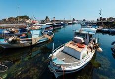 Aci Trezza Marina dei Ciclopi boats harbor, Sicily. Aci Trezza Marina dei Ciclopi boats harbor. Lachea Island on Cyclopean Coast and the Islands of the Cyclops Royalty Free Stock Photos