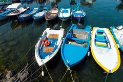 Aci Trezza Marina dei Ciclopi boats harbor, Sicily. Aci Trezza Marina dei Ciclopi boats harbor. Lachea Island on Cyclopean Coast and the Islands of the Cyclops Stock Images