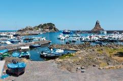Aci Trezza Marina dei Ciclopi boats harbor, Sicily. Aci Trezza Marina dei Ciclopi boats harbor. Lachea Island on Cyclopean Coast and the Islands of the Cyclops Stock Photos
