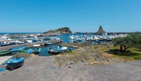 Aci Trezza Marina dei Ciclopi boats harbor, Sicily. Aci Trezza Marina dei Ciclopi boats harbor. Lachea Island on Cyclopean Coast and the Islands of the Cyclops Stock Photography