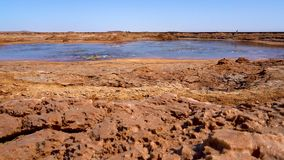 Black poisonous lake in the Danakil depression in Ethiopia. Acid bubbling pond in the Danakil depression in Ethiopia, Africa. stock video footage