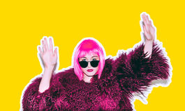 Acid crazy hot beautiful rock Girl in bright pink wig and sunglasses in lama leather swag style red fur winter coat Royalty Free Stock Images