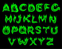 Acid flame alphabet. Vector green flame alphabet on a black background Royalty Free Stock Photo