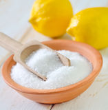 Acid and lemons. Acid in bowl Royalty Free Stock Images