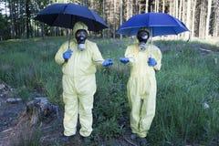 Acid rain. Two experts under acid rain royalty free stock photos