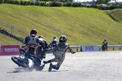 Acidente de Motorscooter na raça foto de stock