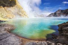 Acidic Lake at Kawah Ijen Volcano, East Java, Indonesia. The turquoise-colored waters of Ijen Lake, the world's largest acidic lake, inside the crater of Kawah stock photos