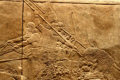 Acient Assyrian art 2. This ancient Assyrian art shows a lion hunt Stock Photos