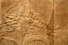 Acient Assyrian art 4. This ancient Assyrian art shows a lion hunt stock photo
