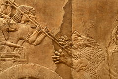 Acient Assyrian art 6. This ancient Assyrian art shows a lion hunt Stock Photos