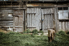 Acient doors. Image of old barn and ancient doors. Stump in the foreground. Shot in Tukums, Latvia Royalty Free Stock Photography