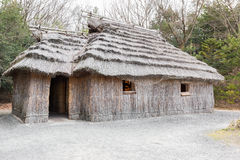 Acient house thatched roof building of Ainu. royalty free stock photo
