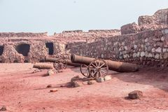 Acient ruins of the desert castel with old guns. View of the acient ruins of the desert castel with old guns Stock Photos