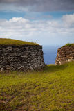 Acient stone houses of Easter Island. Facing Pacific Ocean Stock Image