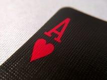 Acima do fim/macro - cartão de jogo preto - Ace de corações Fotos de Stock Royalty Free
