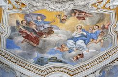 ACIREALE, ITALY, 2018: The ceiling fresco of Immaculate Conception in church Chiesa di San Camillo by Pietro Paolo Vasta. ACIREALE, ITALY - APRIL 11, 2018: The royalty free stock image