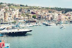 Acitrezza harbor with fisher boats next to Cyclops islands, Catania, Sicily stock photography