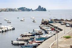 Acitrezza harbor with fisher boats next to Cyclops islands, Catania, Sicily, Italy stock image