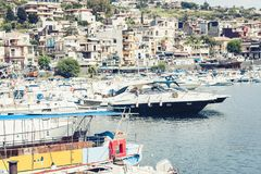 Acitrezza harbor with fisher boats next to Cyclops islands, Catania, Sicily stock image