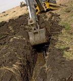 Ackerland-Entwässerungs-Fliese Stockbild