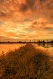 Ackerland im Sonnenuntergang Stockfotos