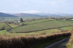 Ackerland und Schnee bedeckten Heidemoor Devon Großbritannien Lizenzfreie Stockbilder