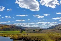 Ackerland und Wolken Lizenzfreie Stockfotos
