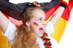 Aclamaciones de la muchacha para las personas de fútbol alemanas Foto de archivo libre de regalías