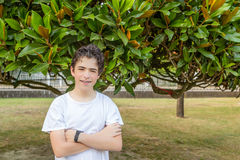Acne teenager with braces under leaves Stock Images
