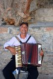 Acordeonista do piano, Agios Nikolaos Fotografia de Stock Royalty Free